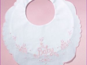 """White Cotton Bib embroidered """"Baby"""" in Pink"""
